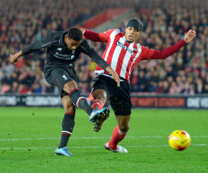 Boom, boom: Two-goal hero Daniel Sturridge fires home against Southampton in the quarter-final of the Capital One Cup at St Mary's last night