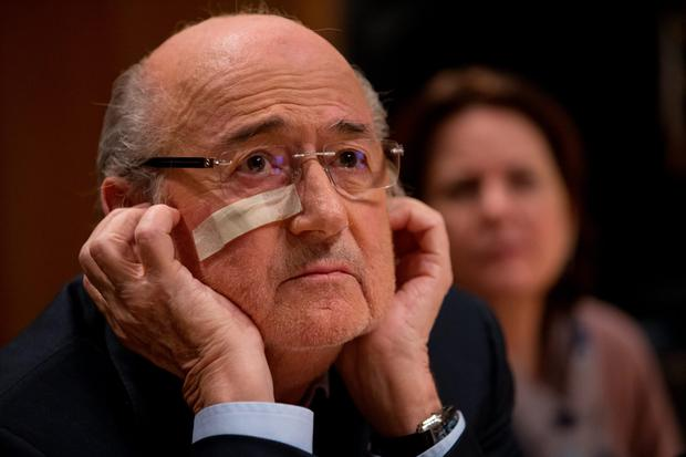 Hear no evil: Sepp Blatter has been banned from football for eight years