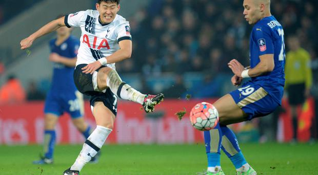Taking aim: Tottenham goalscorer Son Heung-min powers a shot past Leicester defender Yohan Benalouane