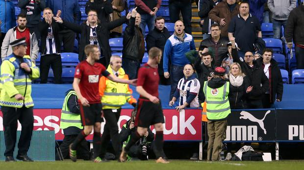 West Brom's Chris Brunt, right, was ushered away by Darren Fletcher after a confrontation with Albion fans