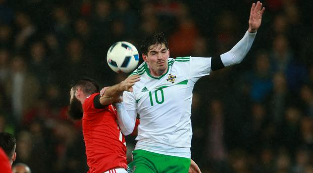 Kyle Lafferty, right, completed a move to Birmingham on Thursday