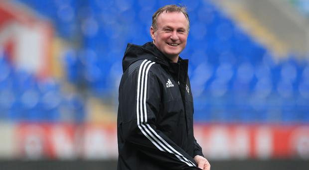 Michael O'Neill will not settle on one preferred system for his Northern Ireland squad