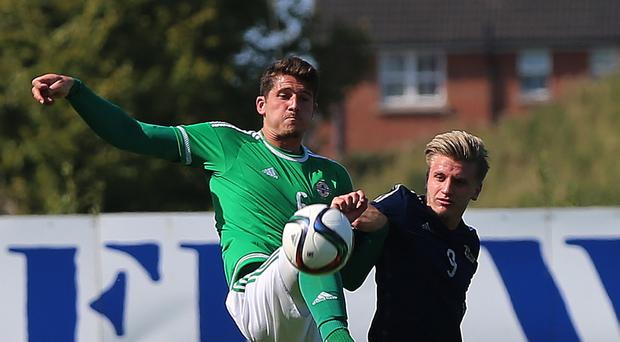 Scotland Under-21s striker Jason Cummings, right, atoned for a first-half penalty miss