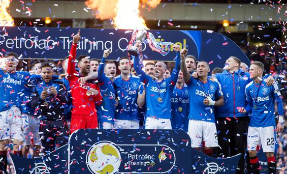 Cuppa cheer: Treble-chasing Rangers players celebrate their final win over minnows Peterhead