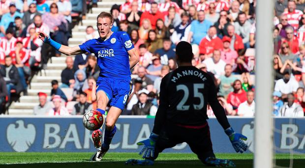 Calm and collected: Jamie Vardy slots the first of his double past Vito Mannone to boost Foxes' bid for the Premier League title