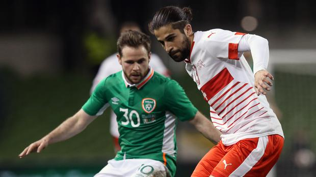 Alan Judge, left, in action for the Republic of Ireland