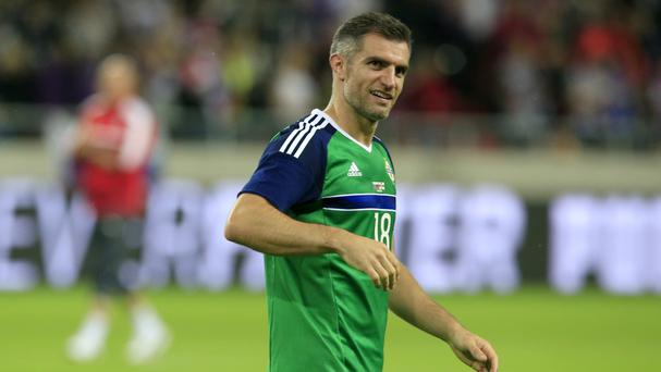 Aaron Hughes smiles after keeping a clean sheet on his 100th appearance for Northern Ireland