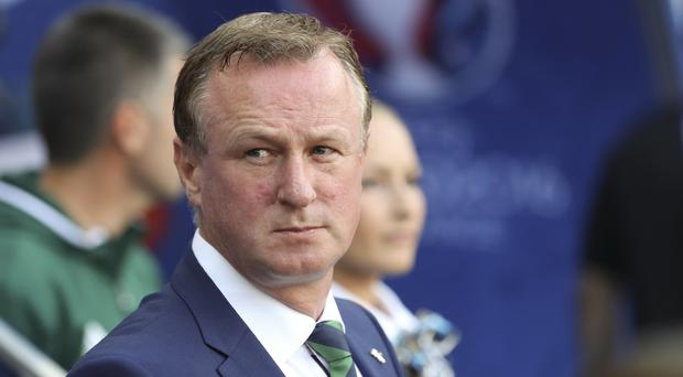 Northern Ireland coach Michael O'Neill said his players were very down following the death of Darren Rodgers.