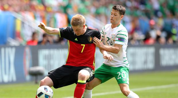 Wes Hoolahan, right, battled for possession with Belgium's star man Kevin De Bruyne
