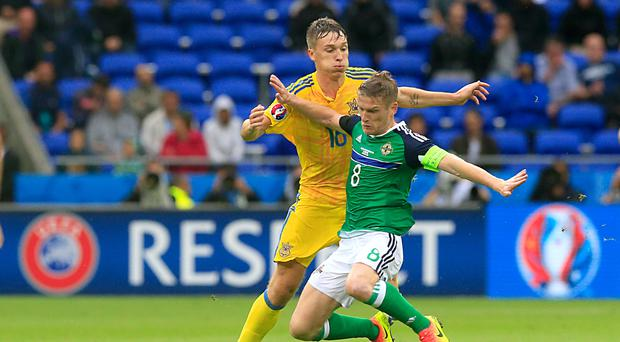 Steven Davis, right, has been lauded by his Northern Ireland team-mate Stuart Dallas