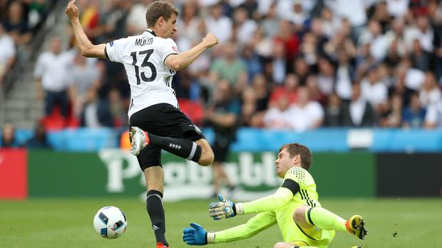 Michael McGovern pulls off a save from Thomas Muller