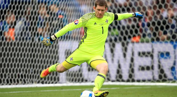Northern Ireland goalkeeper Michael McGovern was kept busy by Germany