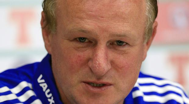 Northern Ireland manager Michael O'Neill admitted to low-key celebrations after his team learned they had qualified for the knock-out stages of Euro 2016