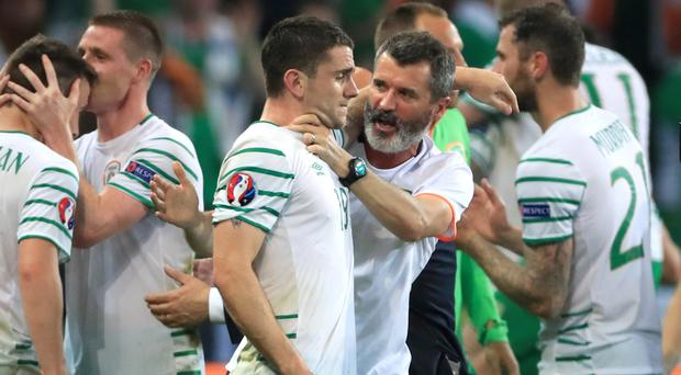 Republic of Ireland's players and staff celebrate qualification