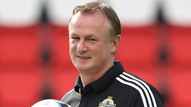 Michael O'Neill's Northern Ireland face Wales in a battle of Britain