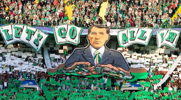 Chipping in: Celtic fans display their support for manager Brendan Rodgers before their side's 5-2 victory over Hapoel Be'er Sheva in the play-off first leg