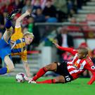 Crunch: Shrewsbury Town's Northern Ireland international Ryan McGivern feels the full force of Wahbi Khazri in Sunderland's victory