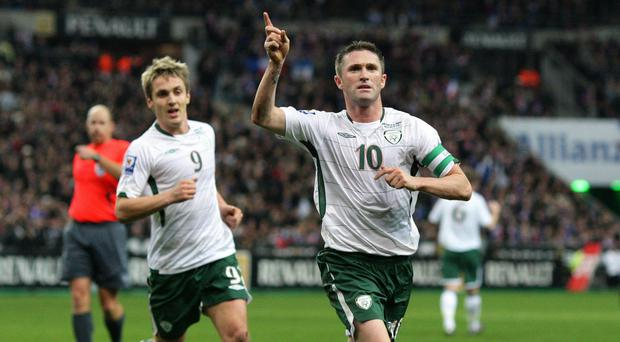 Robbie Keane celebrates after scoring in Paris in the World Cup play-off