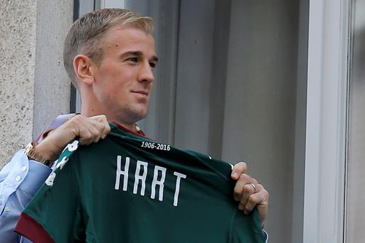 Shirty: Joe Hart shows off a Torino top in Turin yesterday