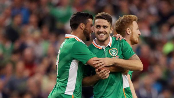 Republic of Ireland midfielder Robbie Brady (right) has been challenged to help fill Robbie Keane's boots