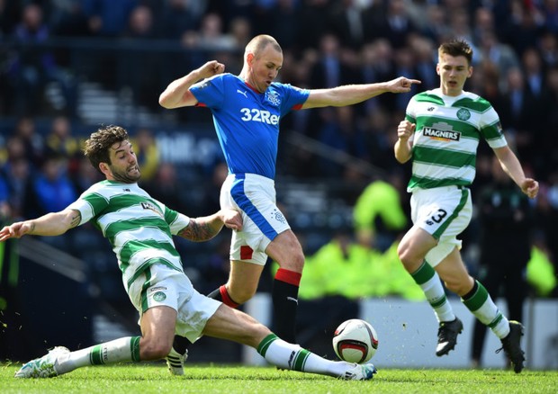 Heat of battle: Gers ace Kenny Miller and Celtic's Nir Bitton fight for possession in last year's Scottish Cup semi-final clash