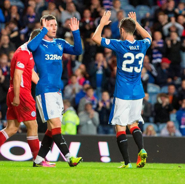 Just for starters: Michael O'Halloran hails team-mate Jason Holt (right) after the latter's opener for Rangers at Ibrox