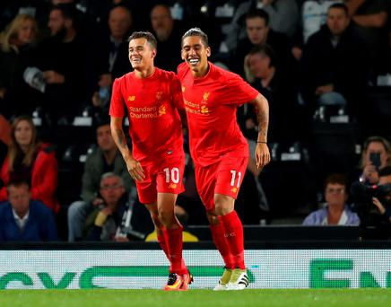 Double act: Philippe Coutinho (left) celebrates with Roberto Firmino after being set up by his Brazil and Pool team-mate