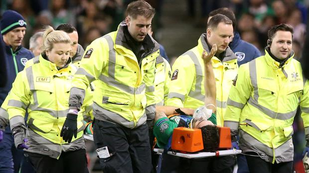Republic of Ireland midfielder Robbie Brady is carried off on a stretcher after a clash of heads during the World Cup qualifier victory over Georgia
