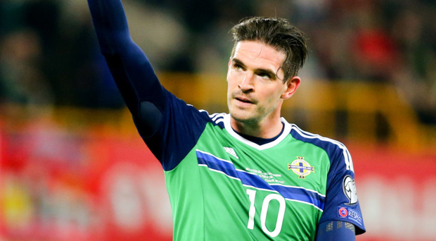 At the double: Kyle Lafferty scored twice against San Marino but doesn't know if it will be enough to earn him a starting role against Germany tomorrow night