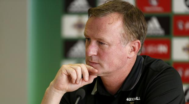 Michael O'Neill has plenty to consider ahead of the Germany game