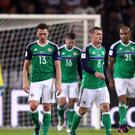Steven Davis, centre, and his Northern Ireland team-mates look dejected during the 2-0 defeat against Germany.