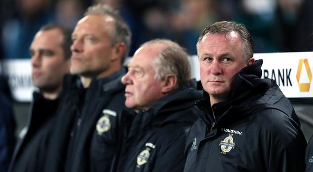 Michael O'Neill, right, thinks Germany are virtually unstoppable