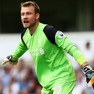 Half chance: Simon Mignolet will start against Tottenham