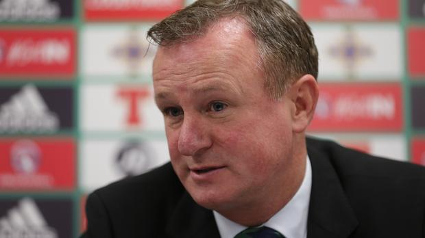 Michael O'Neill's Northern Ireland players will not wear poppies during Friday's game with Azerbaijan following discussions with FIFA