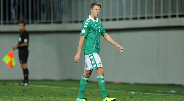 Jonny Evans was sent off at the end of Northern Ireland's previous game against Azerbaijan three years ago