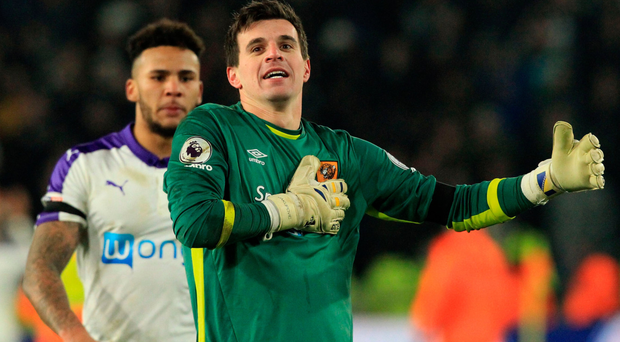 Spot on: Hull's Eldin Jakupovic celebrates after saving from Newcastle ace Yoan Gouffran