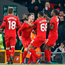 Boy wonder: Ben Woodburn is surrounded by his Pool team-mates after netting the second