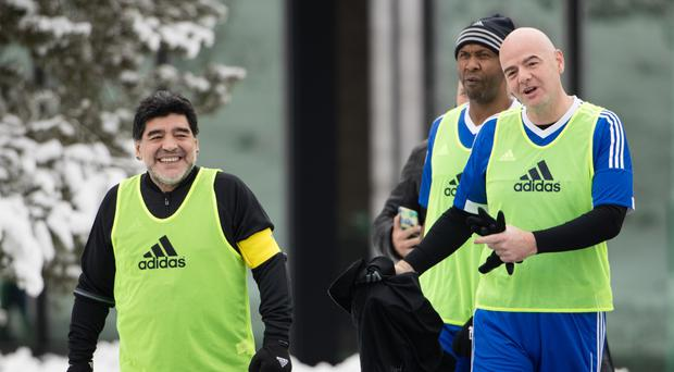 Stuff of legend: Fifa President Gianni Infantino (right) and Diego Maradona arrive for a FIFA legends match in Zurich yesterday