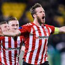 Net gains: Ryan McBride celebrates striking Derry's winner