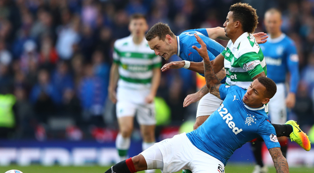 Doubling up: Scott Sinclair of Celtic is tackled by Rangers duo James Tavernier and Clint Hill
