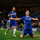 On target: Chelsea's Gary Cahill celebrates after heading home in last night's victory over Southampton at Stamford Bridge as Cesc Fabregas joins the party