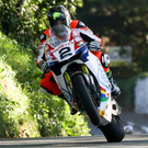 Road to glory: Bruce Anstey sets the pace at the Isle of Man TT