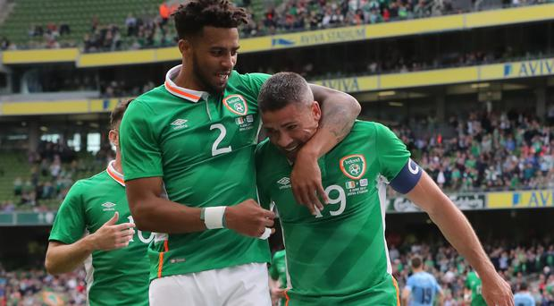 Cyrus Christie, left, scored as the Republic of Ireland beat Uruguay 3-1