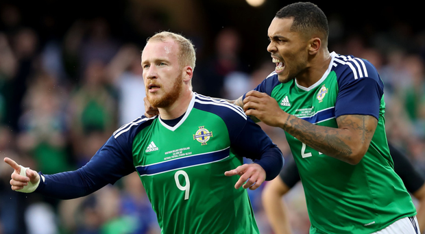 On the rise: Liam Boyce celebrates his first NI goal with Josh Magennis