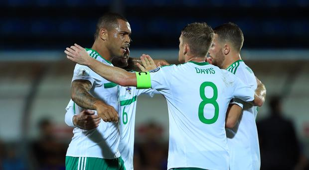 Northern Ireland's Josh Magennis (left) celebrates scoring his side's second goal