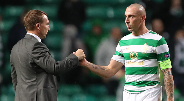 Hands on: Brendan Rodgers and Scott Brown have proved to be a formidable partnership