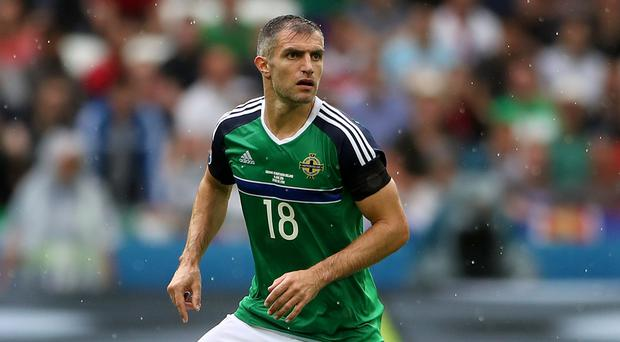 Aaron Hughes picked up a calf problem playing for Hearts at the weekend