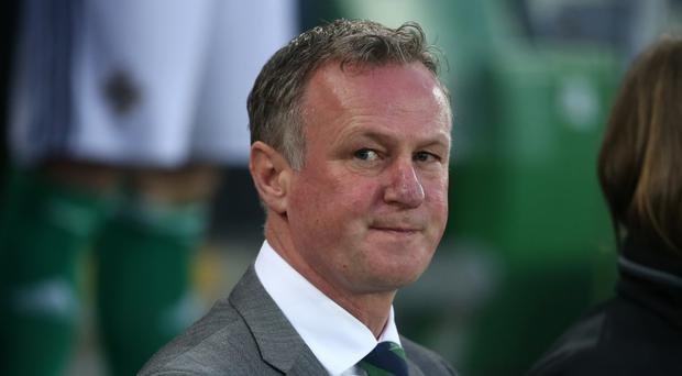 Michael O'Neill is in no hurry to get to the Premier League.