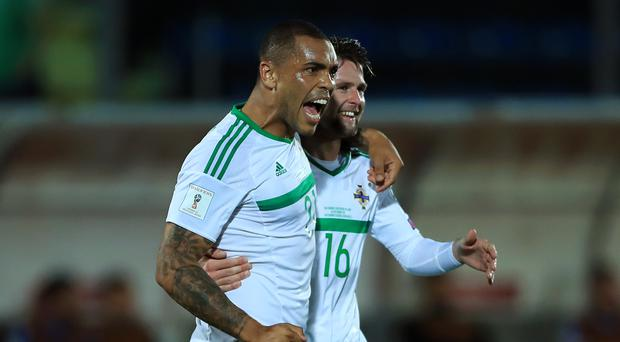 Josh Magennis, left, and Oliver Norwood are two of the players walking a disciplinary tightrope