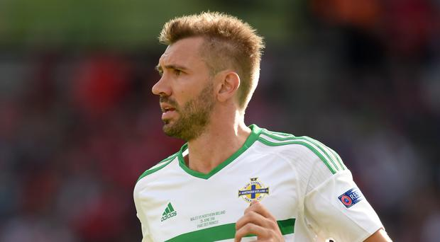 Gareth McAuley is set to win his 75th Northern Ireland cap in the first leg of the play-off next month